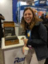 Maya Kaczorowski smiling with an Enigma machine