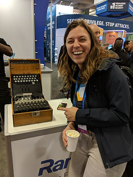 Maya Kaczorowski smiling with an Enigma machine