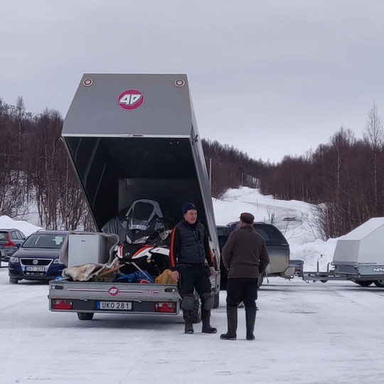 Transporting snow mobiles and other goods