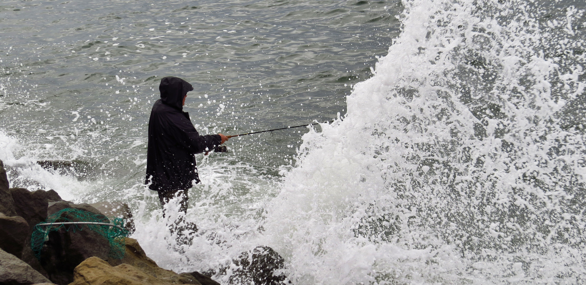 Fishing in the Jetty Waves.jpg