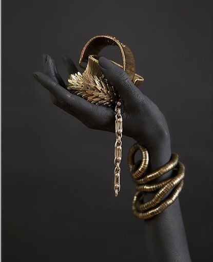 black-woman-s-hand-with-gold-jewelry-wall_edited_edited.jpg