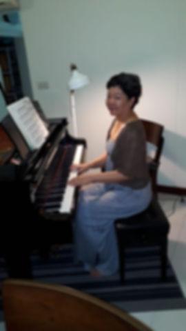 joyce at piano.jpg