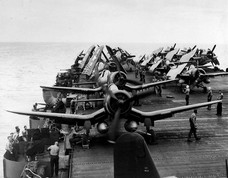 """In the foreground FG-1D Corsairs of VMF-512 USS Sargent Bay CVE-83 June 2 1945. ----------------------------- Credit to US National Archives,  US NAVY, USMC,NACA, San Diego Air & Space Museum Archives (SDASM),Library of US  Congress. ----------------------------- Public domain ; according to the United States copyright law (United States Code, Title 17, Chapter 1, Section 105), in part, """"[c]opyright protection under this title is not available for any work of the United States Government"""". -----------------------------"""