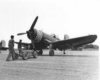 """Ground crewmen arming an FG-1D-Corsair of Marine Squadron 312,Checkerboarders,at Kadena airfield,Okinawa,Japan,Apr-Aug-1945  Credit to US National Archives,  US NAVY, USMC,NACA, San Diego Air & Space Museum Archives (SDASM),Library of US  Congress. ------------------------------ Public domain ; according to the United States copyright law (United States Code, Title 17, Chapter 1, Section 105), in part, """"[c]opyright protection under this title is not available for any work of the United States Government"""". ------------------------------"""