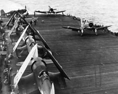 U.S. Marine Corps Vought F4U-2 Corsairs of Marine Night Fighting Squadron 532 (VMF(N)-532) aboard the escort carrier USS Windham Bay (CVE-92) on 12 July 1945.