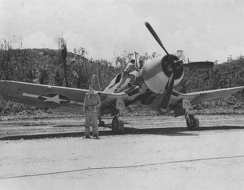 """F4U-1 Corsair of Marine Squadron VMF-215 at the Munda Airstrip, New Georgia, Solomons, 1943. ------------------------------ Credit toUnited States National Archives. ------------------------------ Public Domain. According to the United States copyright law (United States Code, Title 17, Chapter 1, Section 105), in part, """"[c]opyright protection under this title is not available for any work of the United States Government"""". ------------------------------"""
