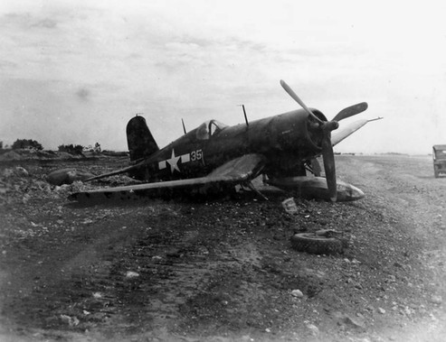 Damaged F4U-1D Corsair fighter of US Marine Corps squadron VMF-314