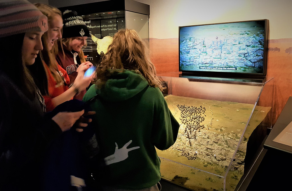 Students at the Canadian Museum of History (Ottawa) at exhibit on Head-Smashed-In Buffalo Jump-evidence of 6000 years of Indigenous presence and knowledge