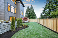 Luxurious contemporary three-story wood siding home exterior in Bellevue. Nice backyard la
