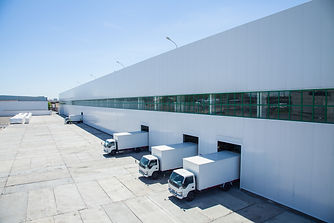 facade of an industrial building and warehouse with freight cars in length.jpg