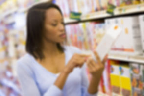Woman Reading Packet In Supermarket.jpg