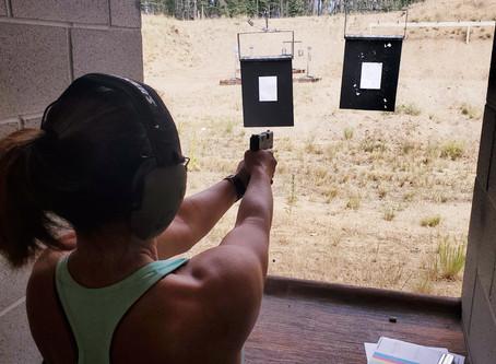 A girl with a gun...