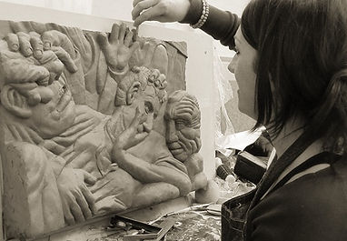 Helena Curry sculpting the clay original