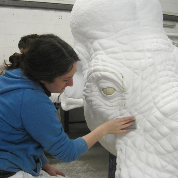 Helena Curry - Art finishing work on a m