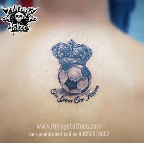 Football with crown tattoo design on bac