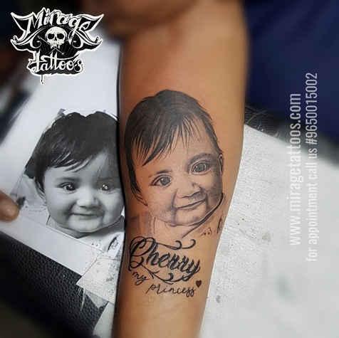 Baby Portrait tattoo design on forearm.j