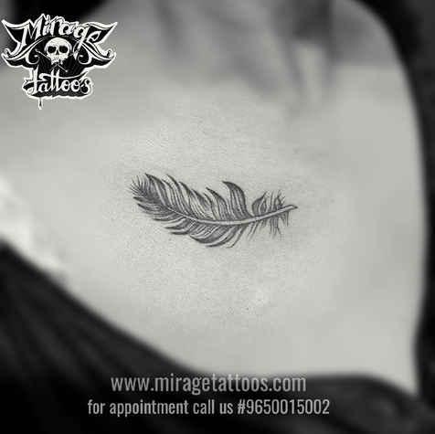 Feather tattoo design on colar bone.jpg