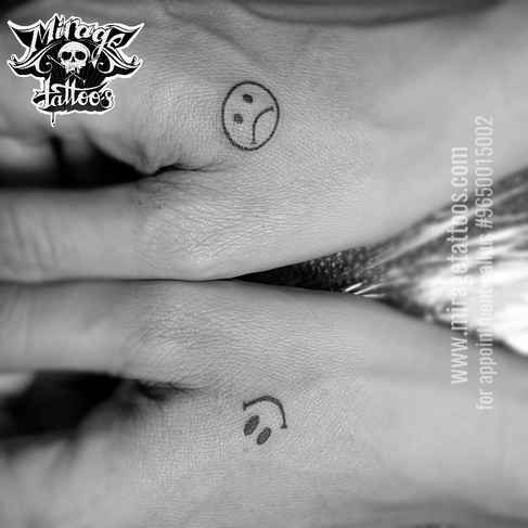Smiley Tattoo design On Hand.jpg