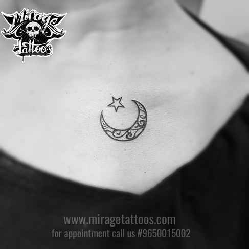 moon with star tattoo on collar bone, ta
