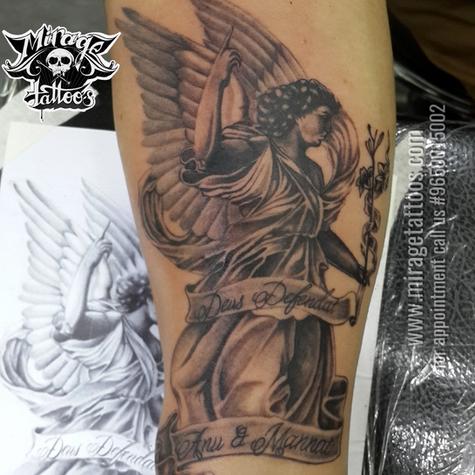 Angel tattoo on forearm dedicate to family