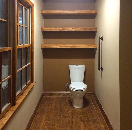 low flow toilet, kohler, shelves, floating shelves, wood floor. tile, porecelain, storage