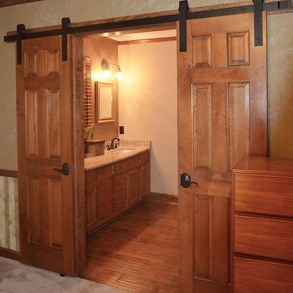 barn doors, recycled, master bath, wood doors, doors, barndoor hardware, granite, double sink, bronze, wood floor tile