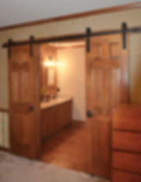 barn doors, recycled, master bath, wood doors, doors, barndoor hardware, granite, double sink, bronze, wood floor tile