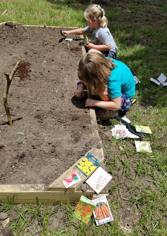 Alice and Ella planting seeds.jpg