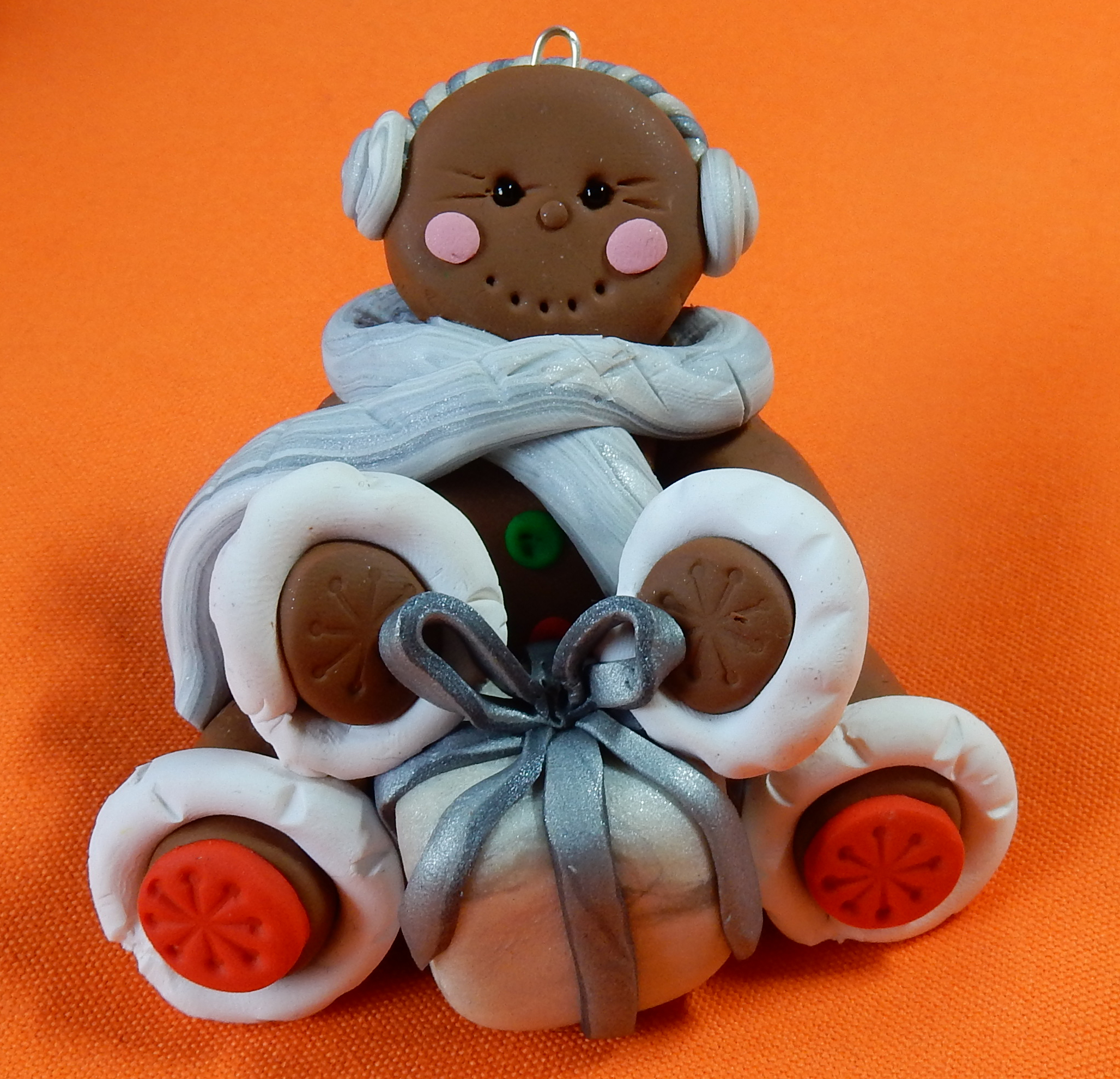 gingerbread lady in grey scarf and ear muffs