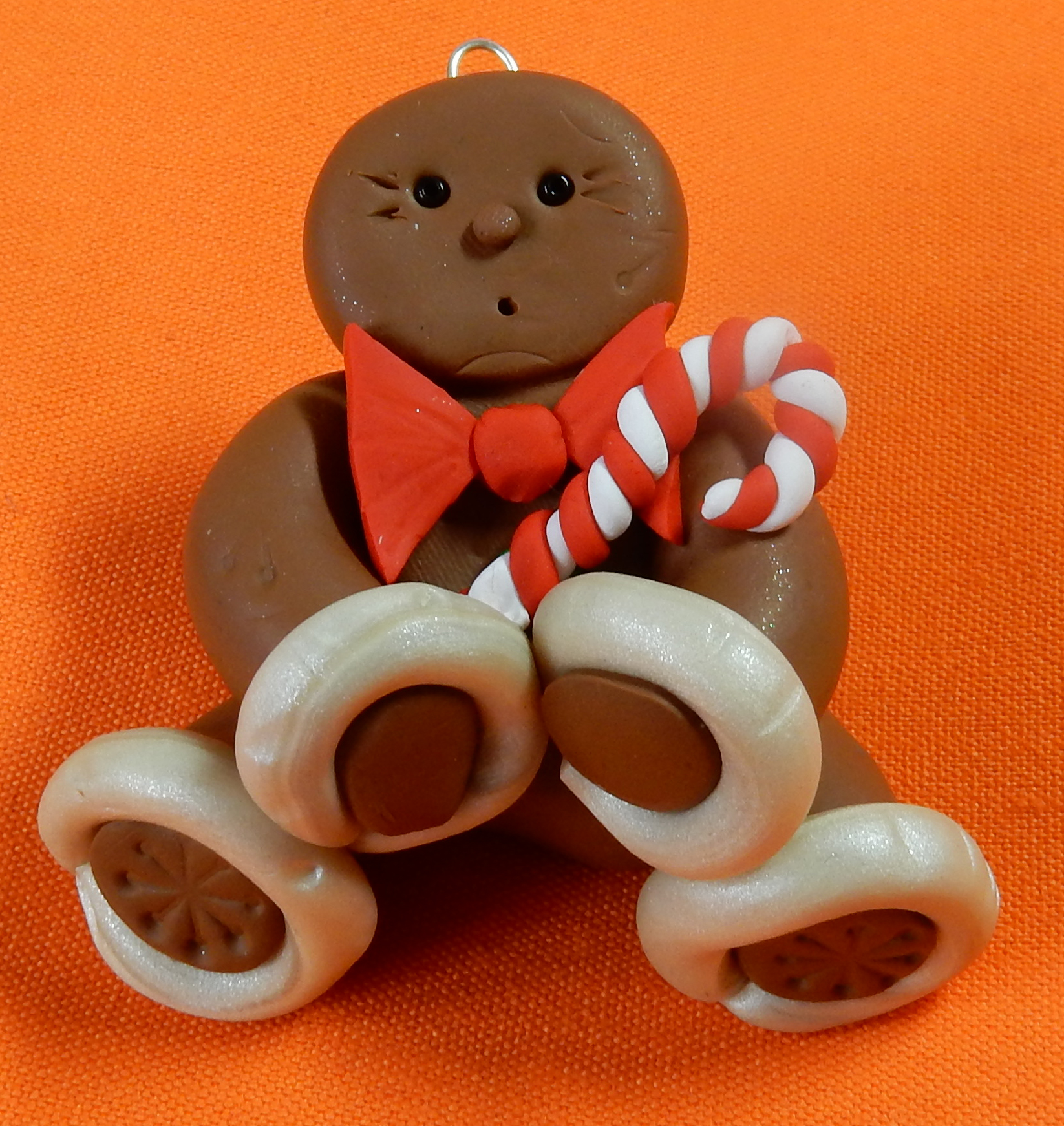 Mr Gingerbread with bow tie and candy cane