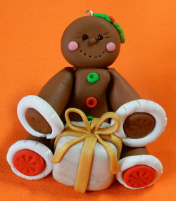 gingerbread lady with white present