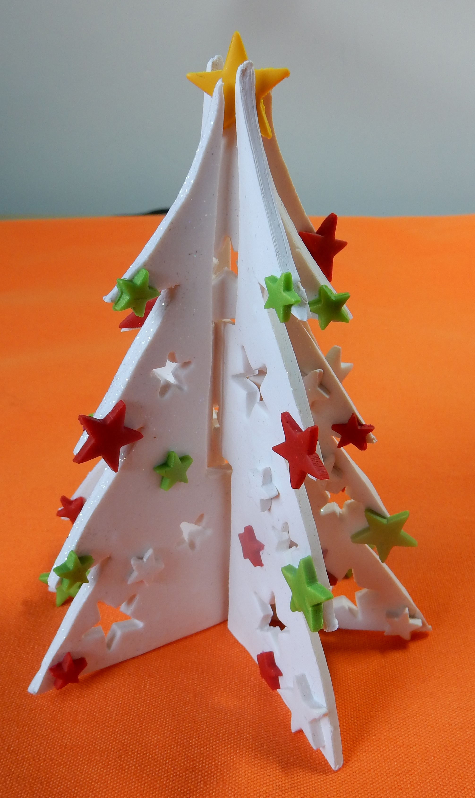 white 3d tree with red green stars
