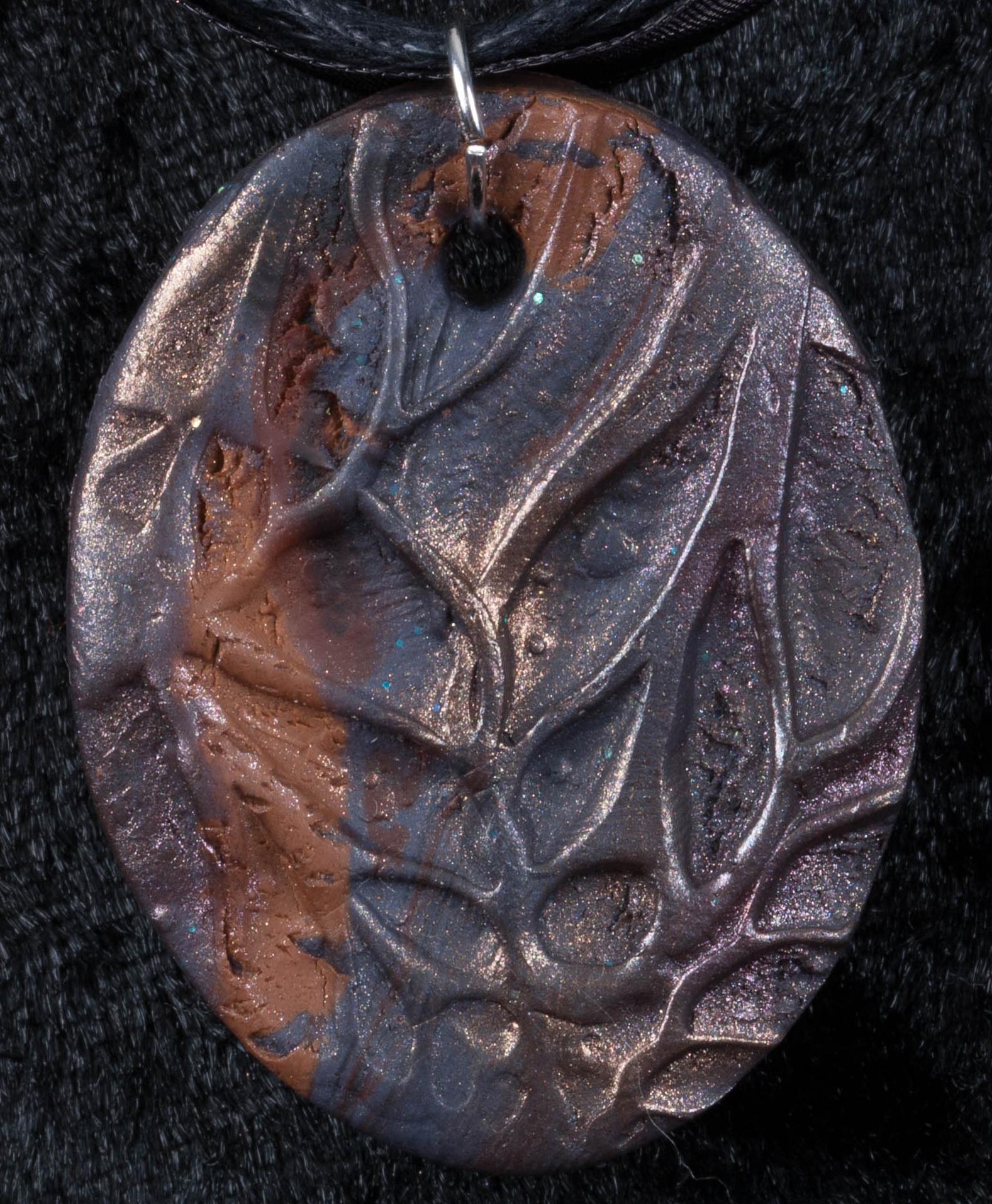 poly brown pendant