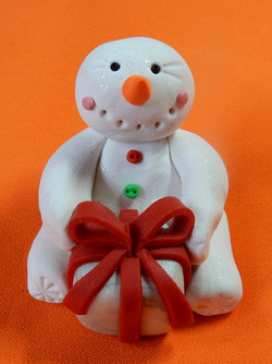 snowman with white present red ribbon
