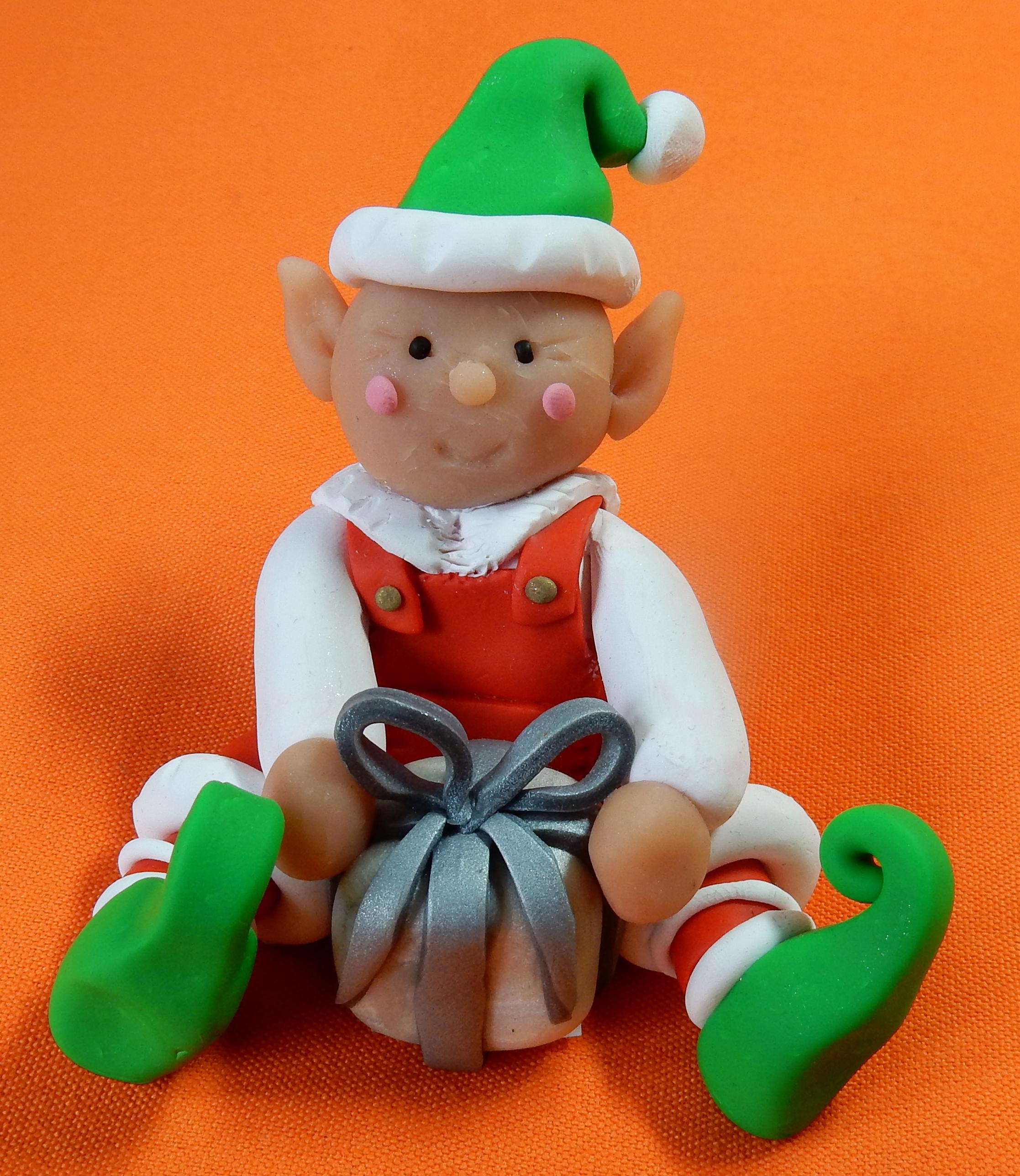 green elf white present