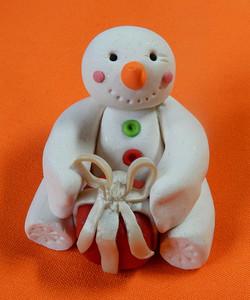 snowman red present