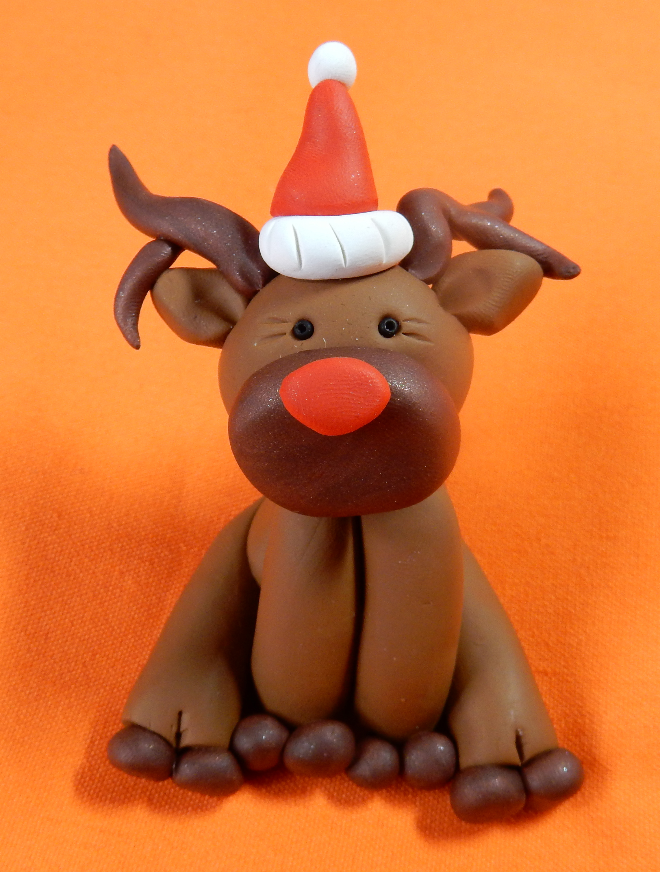 reindeer small red hat