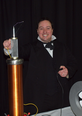 David Hall as Michael Faraday with a Tesla Coil, sparks and a big grin..!