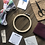 A picture of the supplies from an embroidery kit, including a hoop, fabric, black embroidery scissors, colorful floss.