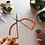 Hope is holding up a pair of embroidery scissors with large, orange handles.