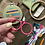 Hope holds up a pair of bright pink embroidery scissors with large, round handles.