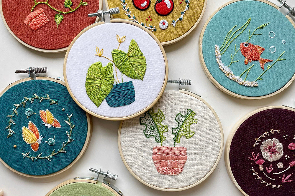 Photo of embroidery hoops in various colors and designs.