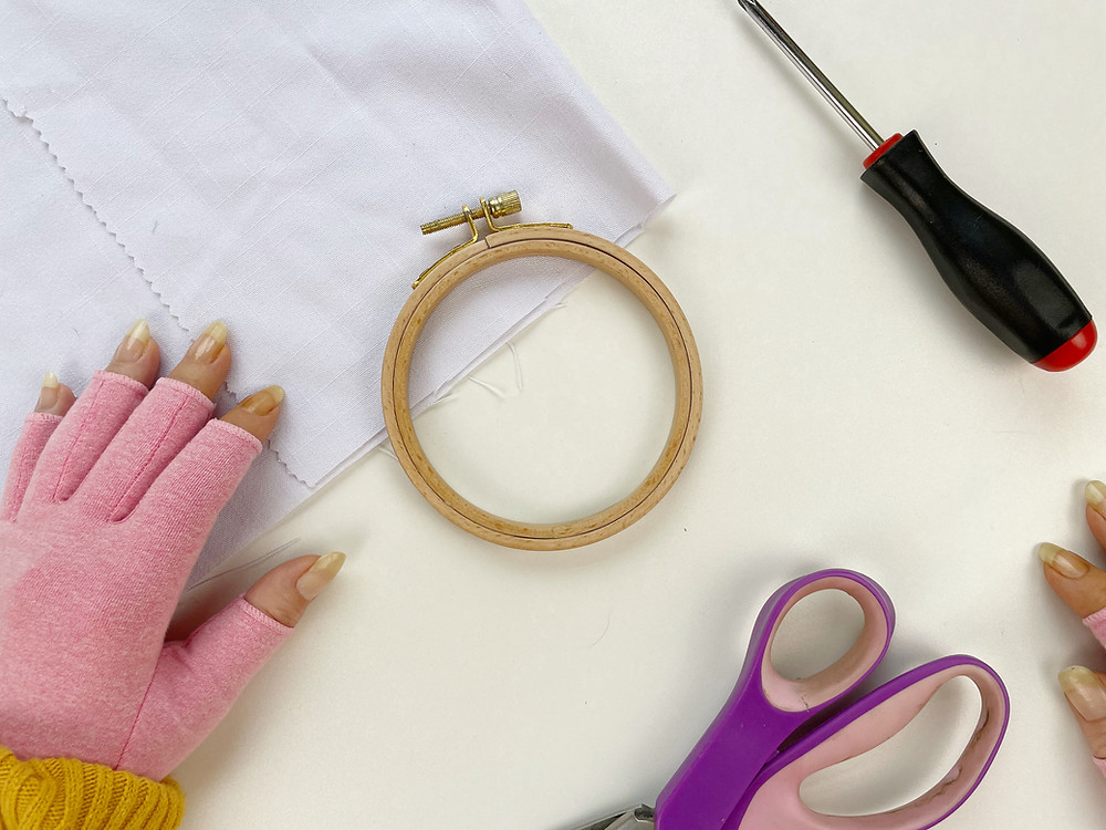 Hope demonstrates how to use an embroidery hoop.