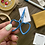Hope holds up a pair of blue, heart-shaped embroidery scissors.