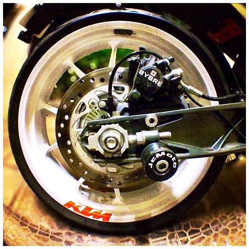 jcMoto KTM Swing Arm Spools.