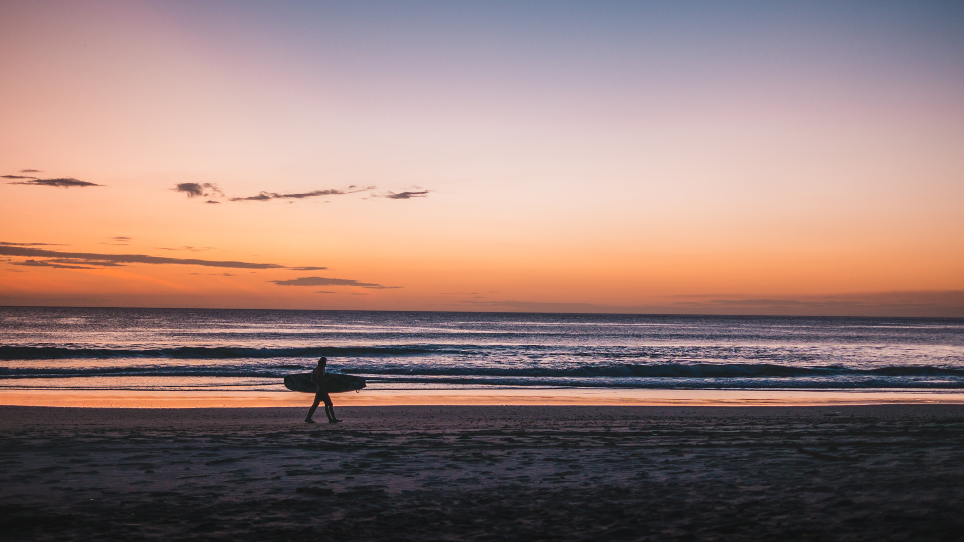 Surfer at the beach at sunset in Nicaragua