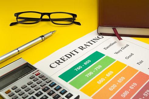 credit-rating-yellow-table-pen-glasses-n