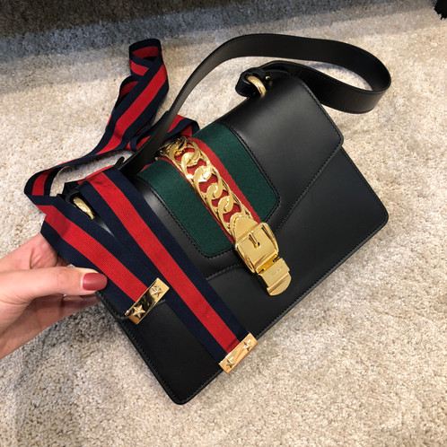8db9479233e8 The top flap opens to a camel microfiber lining interior with a zipper and  patch pocket. This shoulder bag is an ideal statement bag, with the  sophisticated ...