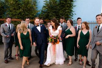 tropical unique san diego wedding inspiration bridal party poses bridesmaid and groomsmen attire inspo vibrant decor dresses flowers