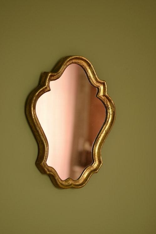 Miroir doré volutes